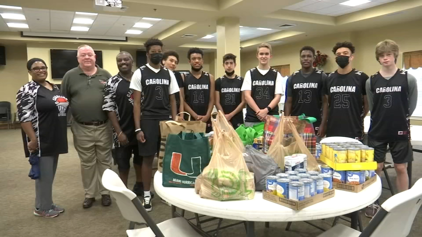 Carolina Ruff Ryder's AAU basketball team skips baskets to donate food and supplies to the Durham Rescue Mission